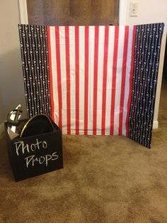 Photo Booth for birthday party.  What you need- cardboard box (paint with chalkboard paint, trifold display board, and table cover. I stapled the pirate theme table cover to the trifold board for the background of the pictures.