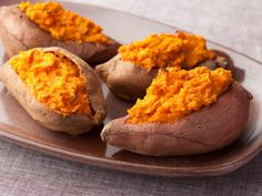 Twice Baked Sweet Potatoes from FoodNetwork.com-- sooo soo soo good! I had smaller sized potatoes, so I used about 2/3 of the suggested extra filling stuff, they were excellent! My boys said they tasted like pumpkin pie. Even the skins were delicious.