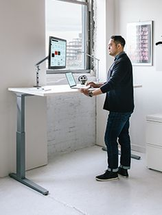 Herman Miller's Renew Sit-to-Stand Tables would be nice for the office. They also come in other wood colors and in L-shaped desks like the ones we have.