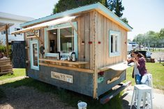 Crafted from barn wood and antique metal, with pretty sky-blue paint trim, Nomad Coffee fits right into the tiny-house trend given its 1971 Go-Tag-A-Long travel-trailer shell. Food Trucks, Donuts, Coffee Food Truck, Drive Thru Coffee, Mobile Coffee Shop, Coffee Trailer, Range Velo, Coffee Shop Business, Food Truck Business