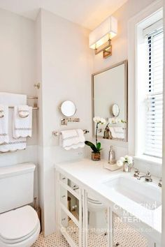 Christina Murphy Interiors    Beautiful bathroom design with light, light gray walls paint color, white mirrored single wide bathroom cabinet vanity with white quartz countertop, Restoration Hardware Nolan Double Sconce, inset medicine cabinet window in front of bathroom sink and marble tiles floor