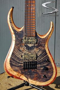 Skervesen chiRoptera 7 NTB, poplar burl top on bubinga middle layer and black limba wings.wenge/bubinga neck,Viper headstock, Dead Space numbers custom inlay Bare Knuckle Pickups Juggernaut calibrated set in camo covers