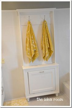 Handy towel rack tutorial. The bottom opens to hold blow dryer, flat iron etc.