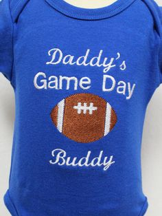 This blue onesie has an appliqued Football and is embroidered with the words (Daddy's Game Day Buddy). This would look adorable on your little quarterback. If you would like this personalized please send me a conversation. This can be made in other colors also. | Shop this product here: http://spreesy.com/DollyWollySewing/135 | Shop all of our products at http://spreesy.com/DollyWollySewing    | Pinterest selling powered by Spreesy.com