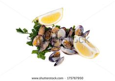 Boiled clams with lemon slices on white background. by eZeePics Studio, via Shutterstock