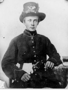 """A very young """"soldier""""wearing a """"brand new""""  dress coat and army dress hat during the Civil war"""