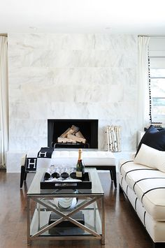 this is also a very nicely designed fireplace. it reminded me a bit of yours because they both are just a small rectangle in the wall without any ornate surrounds. Also the overall look of the space is inviting. is this too light a space for what you are after? would you like it to be more of a combination of the light and the darker tones?