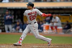 Yoan Moncada #65 of the Boston Red Sox hits a two-run rbi double against the Oakland Athletics in the top of the third inning at Oakland-Alameda County Coliseum on September 3, 2016 in Oakland, California. The double was Moncada's first career major league hit.