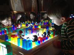 Light table and clear blocks gives children a new way to explore with shapes, colour and light.