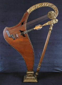 "Although most people look at this and see ""weird guitar harp thingy"" I know that this is a harp and mandolin.  There are eight tuning pegs, but the picture only shows four strings.  A mando.  That doesn't tell me whether it is a mandolin or mandocello, etc, however.  Not to sound snooty."