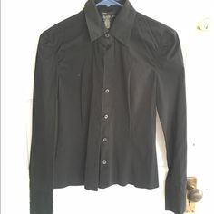 Black dress shirt Nice black shirt with a bit of detailing around the sleeve.  The color is black, my camera is making it looked washed out, but the shirt is in good shape. Fits more like a 2 or a small though the label states 4. BCBGMaxAzria Tops Button Down Shirts