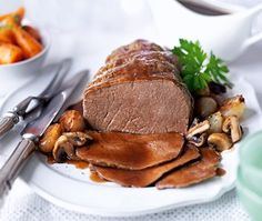 Beef Topside: Slow-cooked topside of beef in red wine