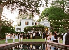 backyard wedding with string lights by kaitlin
