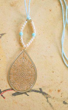 Delicate treasure. bohemian gold pendant, pearl string necklace. Tiedupmemories via Etsy