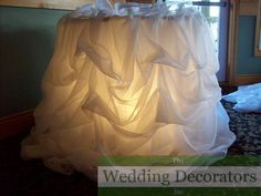 Love the idea of illuminating a white table cover.