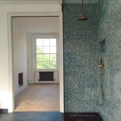 Terrazzo shower by Heirloom Studio - Green terrazzo. Terrazzo tiles.Terrazzo and brass. Terrazzo. Interior Design.
