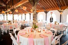The Pavilion - shown with round tables, pink, lights and globe type hangings, which is similar to what we will have. Not sure if we're doing light pink napkins or ivory on ivory.
