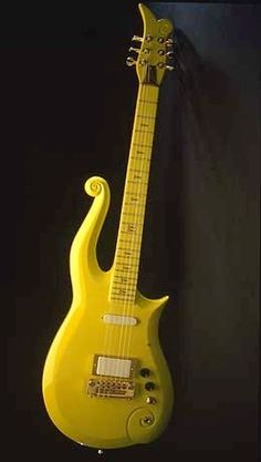 Prince's Yellow Cloud, David Rusan and Barry Haugen of Knut-Koupee Enterprises, Inc. Minneapolis, MN.1989  This guitar was designed by Prince for his exclusive use and was custom-made by Minneapolis craftsmen. The musician's distinctive personal symbol adorns both the top and the side of the fingerboard.