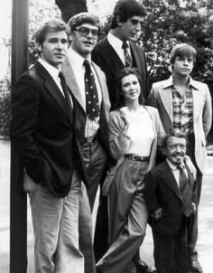 No matter how many times I see them all stand next to each other, I can't get over how much taller Harrison Ford is compared to Carrie Fisher.     Wow...six people, including one under 4 feet tall, and that's what I notice?