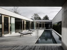 A slender swimming pool runs along one side of this concrete house in western Austria by Marte.Marte Architects, offering bathers views towards the Rhine Valley.