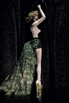 Peacock feather bustle train attached to short shorts  Alison Goldfrapp wearing golden Lola wedges by Terry de havilland