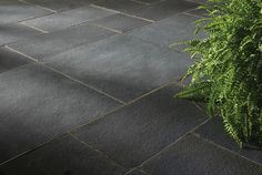 """BLACK LIMESTONE   STONE TYPE: LIMESTONE   TOP FINISH: NATURAL   BOTTOM FINISH: NATURAL OR CALIBRATED   EDGE FINISH: SAWN   DIMENSIONS: 1'X1' TO 2'X3'   THICKNESS: 1"""", 1.25"""", 2"""", 6""""   ALSO AVAILABLE IN:  COPING, TREADS, STEPS"""