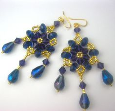An Evening In Paris.  Can't decide if I want to list these or not.  They are so pretty and they are my very first pair.  Made from TOHO gold plated beads, Jewelry Basics Mirrored Beads, Crystazzi crystals, Elegance Metals Earwires