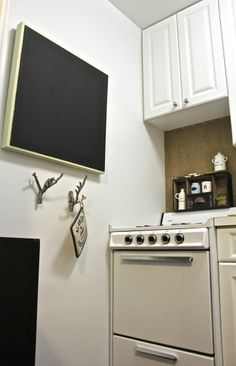 Use chalkboard paint to cover up any other canvas/print for new decor