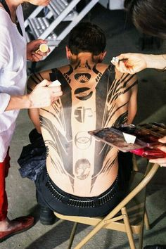 Reasons to become a makeup artist for movies: you get to paint all over Theo James' bare back.