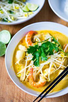 Coconut Laksa Soup w/ Chicken and Shrimp over rice noodles.... Slurp slurp!  | www.feastingathome.com