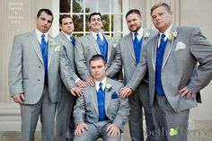 I like how bright the blue is here, but to casual it a bit: no jacket, vests gray, blue ties for groomsmen, white tie for groom, and white shirt folded to 3 quarter sleeve length
