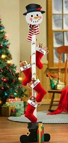 Christmas stocking stand (Or maybe with clothespins all around for Christmas card display) rustic Christmas decorating Christmas Wood Crafts, Decoration Christmas, Farmhouse Christmas Decor, Christmas Snowman, Xmas Decorations, Christmas Projects, Simple Christmas, All Things Christmas, Christmas Home