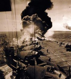 USS Belleau Wood (CVL 24) showing fire on flight deck following a kamikaze attack on 30 October 1944.