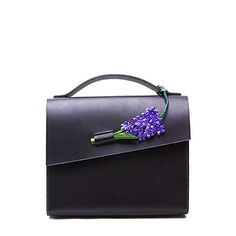Black vegetable tanned leather handbag with handcrafted leather hyacinth flower strap. Handmade in England. Available on DreamsCode.co.uk