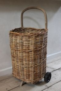 "Wicker Shopping Basket on wheels carries all your ""vintage finds"" & market place treasures/looks fabulous in the process.."