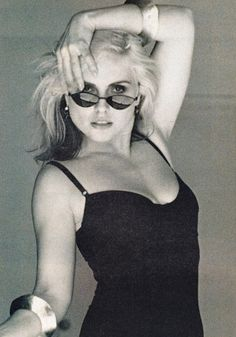 A little black dress & a smart pair of sunglasses. Simple yet powerful.