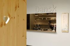 Dansk is a café located at the Danish Design Center, redesigned by Remove with the n. Coffee Shop Interior Design, Coffee Design, Wine Bottle Design, Small Cafe Design, Cafe Restaurant, Restaurant Ideas, Danish Design, Retail Design, Wood Furniture