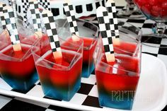 Race Car Party Kids party treats for a Disney Cars party. Layered blue and red jello cups with wooden spoons wrapped in checkered duck tape. Cute!