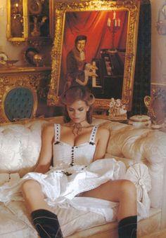 Vogue Paris, April 1977 Model: Lisa Taylor Photographer: Helmut Newton. Please note the portrait of Liberace in the background!