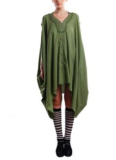 This unconventional olive shirt dress by Vijay Balhara on strandofsilk.com oozes casual style. An asymmetric mirror worked hemline, a casual loose fit and a versatile draped fall, it would create the perfect boho-chic look when worn with a pair of chunky heeled boots #vijaybalhara #mirrorwork #shisha #applique #asymmetric #versatile #casual #bohochic #shirtdress