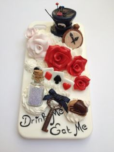 Alice In Wonderland cell phone case http://freakyfairyfactory.blogspot.com/2012/08/decoden-iphone-case-alice-in-wonderland.html