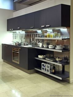 A small kitchen with contemporary black cabinets, open shelves, and a stainless steel backsplash... Photo #9 in Modern Black Kitchens