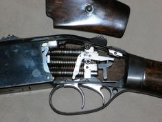 ??????????????????????  I believe this is an antique  ( over/under ) double barreled   Shotgun. Correct me if I am    wrong ( please )   :)