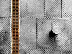 take a close look at the pattern and how it crosses between pavers (I assume those are pavers)