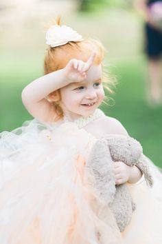 How sweet is this little flower girl?! http://www.stylemepretty.com/massachusetts-weddings/rockport-massachusetts-united-states/2015/11/20/high-school-sweethearts-labor-of-love-wedding-in-rockport-massachusetts/   Photography: Ruth Eileen - http://rutheileenphotography.com/