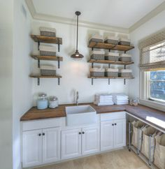 2013 Southern Living Custom Builder Showcase Home at St. Simons Island beach style laundry room