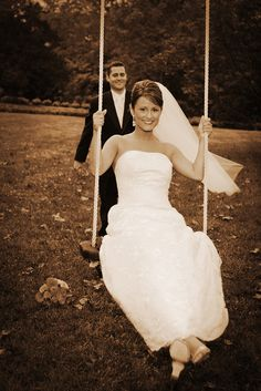 NC wedding photograph of bride on a swing pushed by her husband
