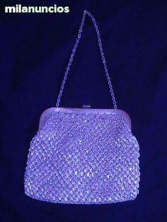 . Se vende bolso de fiesta de hilo de plata a 60 €