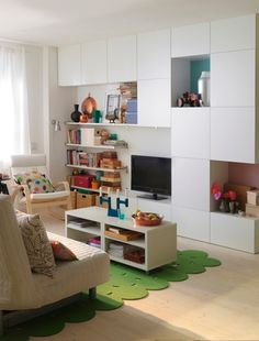 Bookshelves, cupboards and open shelves - all are a must if youre looking for plenty of space to tidy away everyday clutter in a small living room. Storage units by Ikea.
