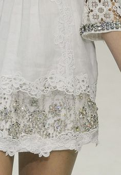 such pretty detailing on this dress the contrast of white lace and edgy sequins is wonderful